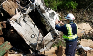 NTSB investigators examine the damaged truck. Source NTSB