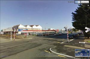 Nith Street active open level crossing from Tyne Street, Invercargill. Source, Google Street view
